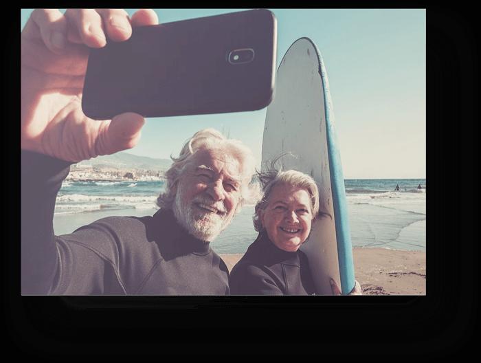 Older-Couple-Taking-Selfie-Surf-Board-700px